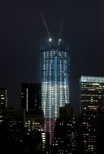 The 1 World Trade Center, due to be completed in 2013, shines under red, white and blue lights to commemorate the 10-year anniversary of the September 11 attacks.