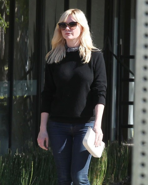 'Midnight Special' actress Kirsten Dunst does some solo shopping on Melrose in West Hollywood, California on November 25, 2014.