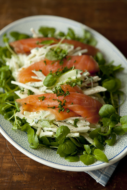 celeriac apple remoulade on watercress topped with salmon