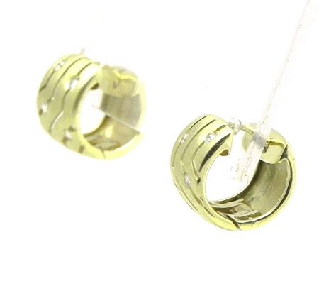 ladies  yellow gold diamonds hoop huggie earrings