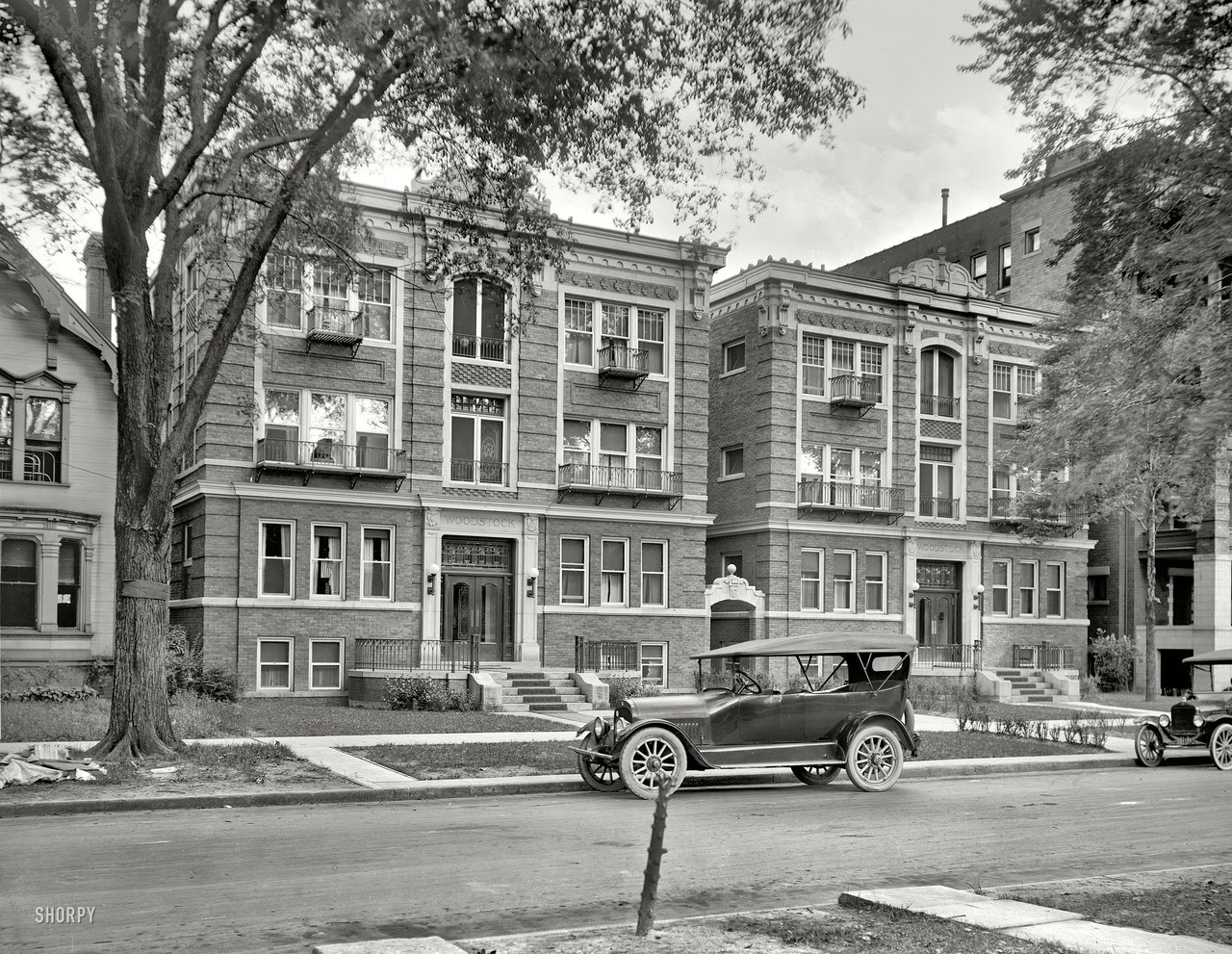 A car parked outside of the Woodstock Apartments... | Old Detroit ...