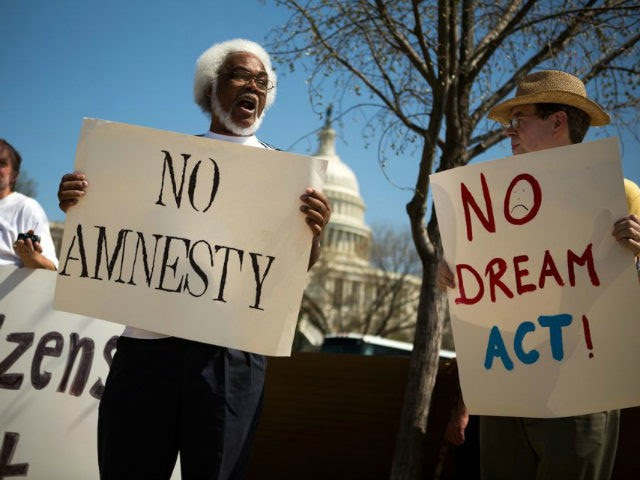 Tabu Henry Taylor (C) of Washington DC, and Mike Crowe (R) of Springfield, Virginia, join a handful of protesters from anti-amnesty groups, including New Yorkers for Immigration Control and Enforcement (NY ICE) and The Tea Party Immigration Coalition, to demonstrate in front of the U.S. Capitol building April 10, 2013 …