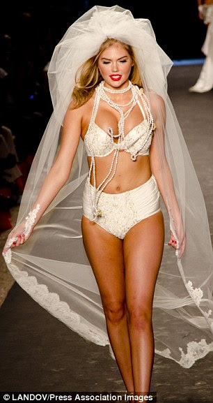 Bridal bikini: The blonde even modelled a floor-length veil on the catwalk