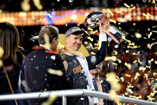 Peyton Manning hoists the Vince Lombardi trophy after his Denver Broncos defeat the Carolina Panthers, 24-10, in Super Bowl 50...on February 7, 2016.