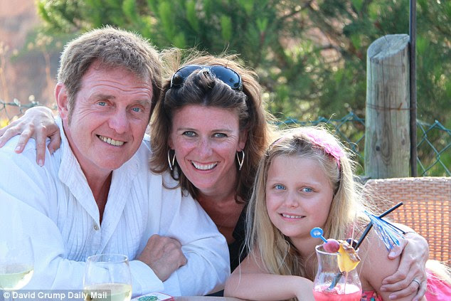 Devoted: Alvin with his beloved wife Julie and daughter Millie Margaret Mary at their home in Ifold, West Sussex
