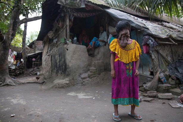 Family: Khadija Khatoon, 21, in front of her home