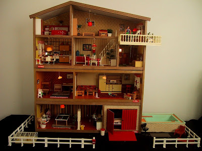 Vintage mid-1970s Lundby dolls' house with two floor extensions, pool and fence.