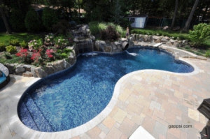 Travertine Surrounding a Free Form Pool, Manorhaven, NY ...