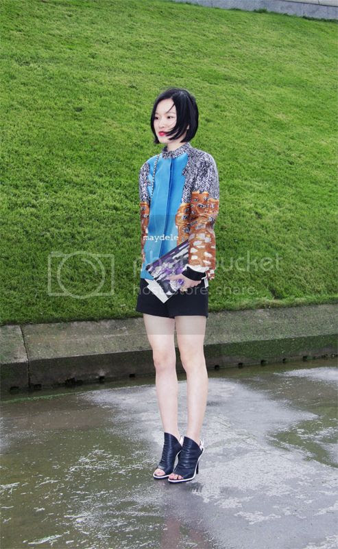 Numero China fashion editor wearing Balenciaga jacket and glove sandals with Anselm Reyle for Dior clutch