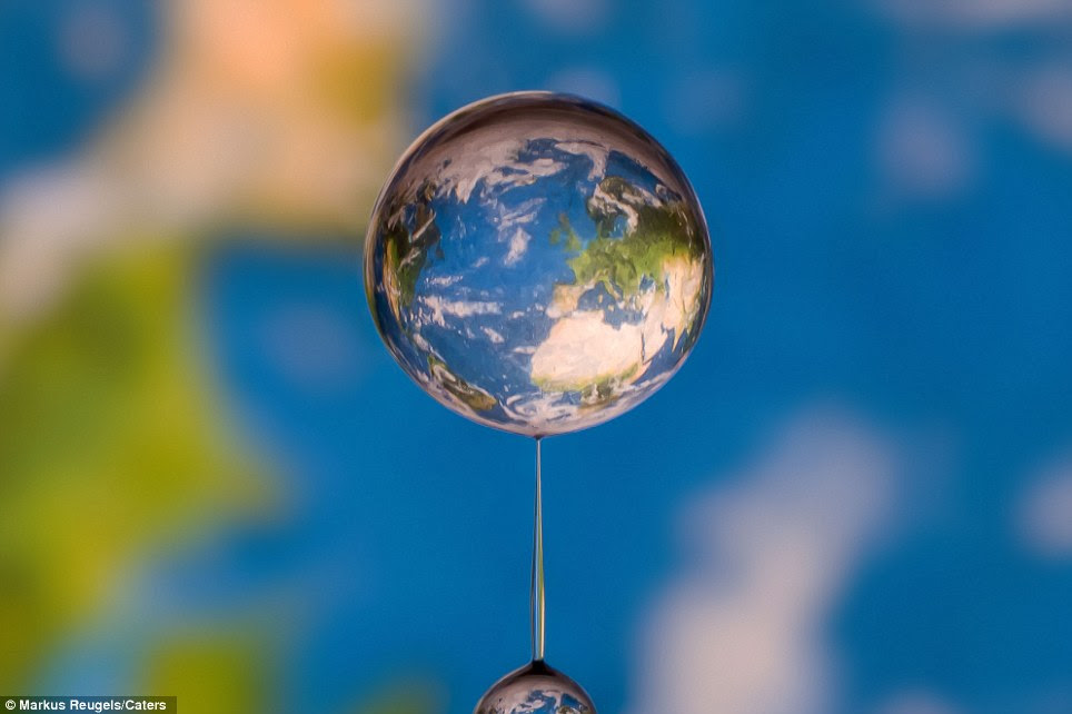 The stuff of life: The globe pictured through a drop of water