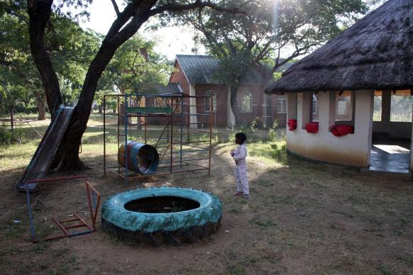 Tinotenda Zamchiya, 4, was playing on the Nyadire United Methodist Hospital playground three days after she began treatment for a serious case of malaria. Photo by Vicki Brown, UMNS.