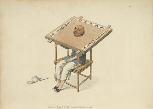 Man sitting with wooden neck torture/restriction device. (1804)