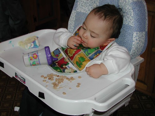 Baby Adam eats his Cheerios