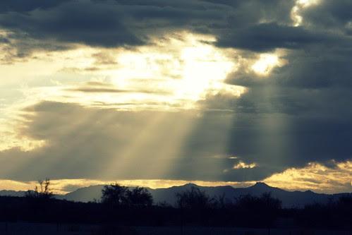 God's fingers shining through