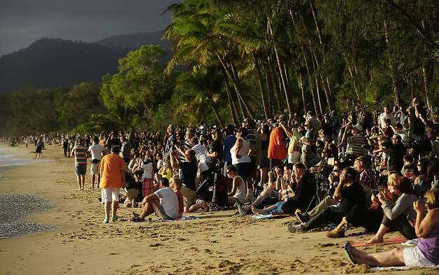 Spectators line the beach to view the total solar eclipse on November 14, 2012 in Palm Cove, Australia. Thousands of eclipse-watchers have gathered in part of North Queensland to enjoy the solar eclipse, the first in Australia in a decade. Photo: Ian Hitchcock, Getty Images / SF