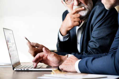 Businessmen using ERP system