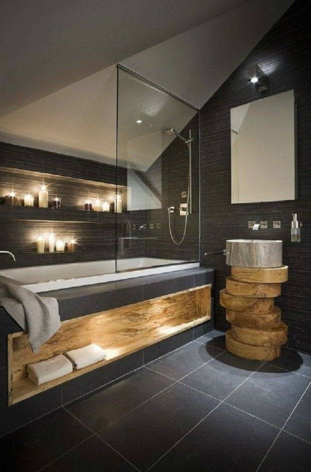 Gorgeous slate bathroom with live edge wood slab accents.