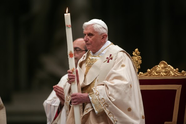 VATICAN CITY- MARCH 22:  Pope Benedict XVI holds a candle as he celebrates Easter Vigil mass in Saint Peter's Basilica March 22, 2008 in Vatican City. The Pope baptized seven converts including a former Muslim during the annual mass the night before Easter Sunday.