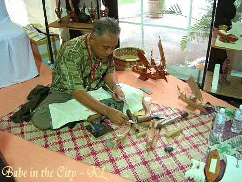 Man from Semporna carving out ships