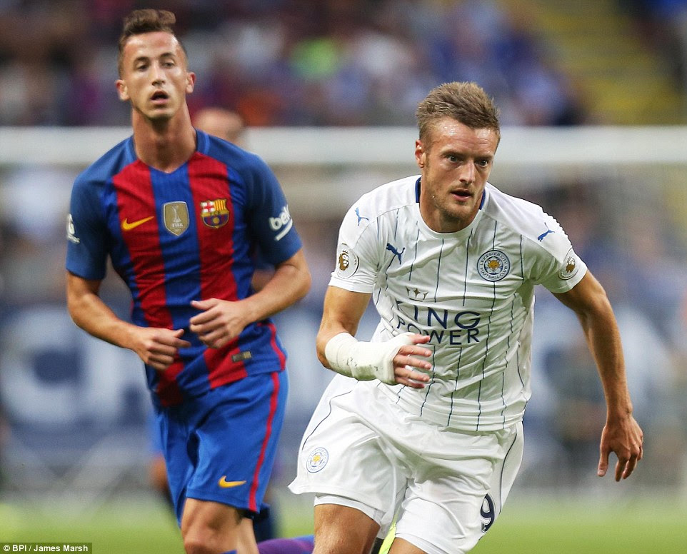 Jamie Vardy looks to attack a loose ball as Barcelona defender Juan Camara gives chase during the opening 45 minutes