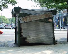 damaged newsstand