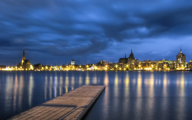 Rostock as seen over the Warnow river after twilight