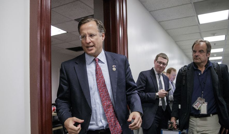 Rep. Dave Brat, R-Va., a member of the House Freedom Caucus whose conservative GOP members derailed the Republican health care bill last week, leaves a closed-door strategy session with Speaker of the House Paul D. Ryan, R-Wis., and the leadership as they try to rebuild unity within the Republican Conference, at the Capitol, in Washington, in this Tuesday, March 28, 2017, file photo. (AP Photo/J. Scott Applewhite) ** FILE **