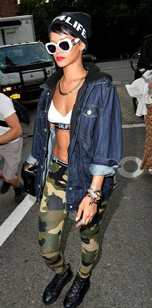 rihanna displays  rock hard abs   bra  camouflage