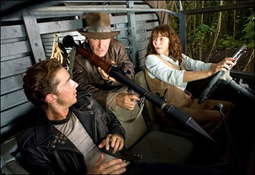 Mutt Williams and Marion Ravenwood look on as Indy brandishes a rocket launcher in INDIANA JONES AND THE KINGDOM OF THE CRYSTAL SKULL.
