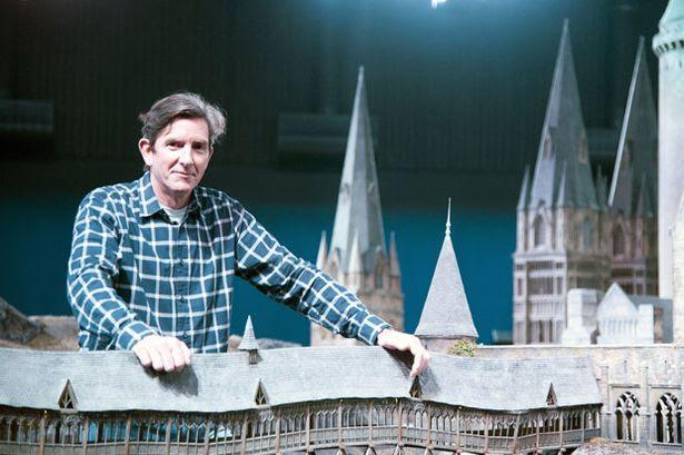 Model Designer Jose Granell poses at the Hogwarts Castle scale model