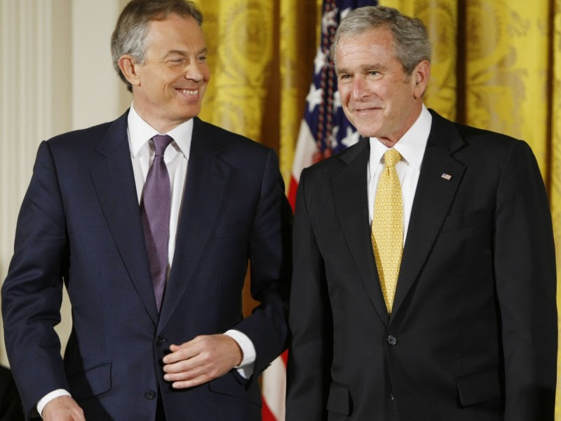 President George W. Bush and former British Prime Minister Tony Blair nudge each other in the East Room of the White House in Washington, Tuesday, Jan. 13, 2009, during a ceremony where the president presented Blair with the Presidential Medal of Freedom. (AP Photo/Gerald Herbert)