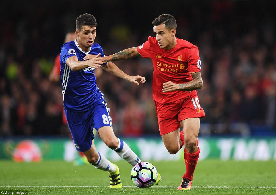Oscar presses Coutinho in a battle between Brazilians during the first half the Friday night's Premier League clash
