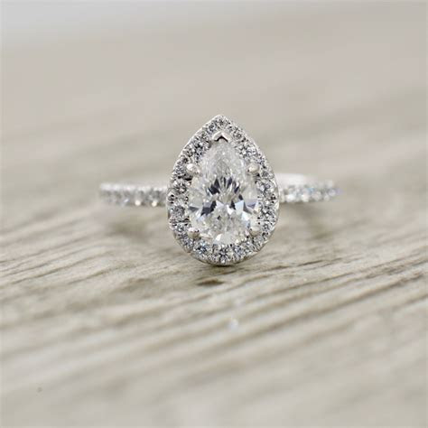 Pear Brilliant in a French Pavé Halo & Stem Engagement
