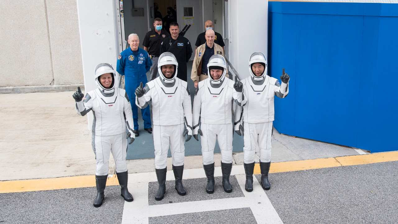 NASA astronauts Shannon Walker, left, Victor Glover, and Mike Hopkins, and Japan Aerospace Exploration Agency (JAXA) astronaut Soichi Noguchi, right, wearing SpaceX spacesuits, stop to pose for a picture as they walk out of the Neil A. Armstrong Operations and Checkout Building to depart for Launch Complex 39A during a dress rehearsal prior to the Crew-1 mission launch, Thursday, Nov. 12, 2020, at NASA's Kennedy Space Center in Florida. Image Credits: NASA/Joel Kowsky