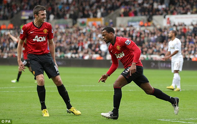 Head boy: Patrice Evra nodded home Robin van Persie's corner to give Manchester United the lead