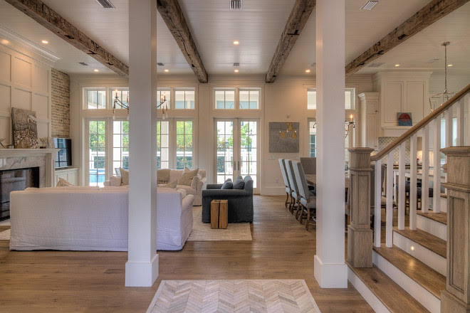 Beach house with reclaimed wood beams and white shiplap walls. 30A Interiors