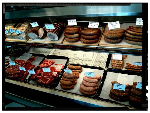 The well-stocked meat case at Piggyback Deli inside a Lynnwood gas station.