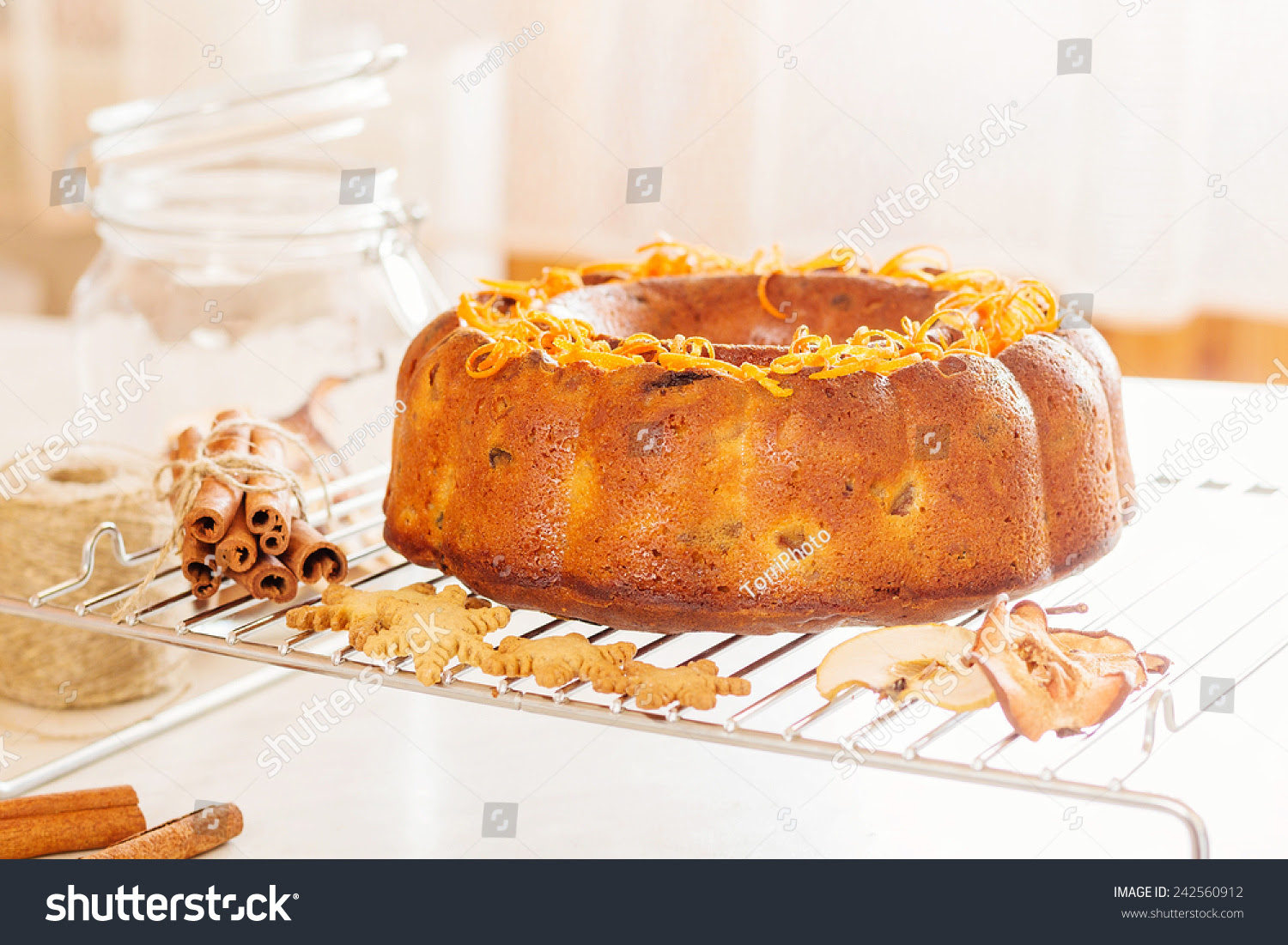 http://www.shutterstock.com/pic-242560912/stock-photo-bundt-cake-with-citrus-peel.html