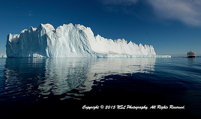 Tabular Iceberg Alley at Renland, off Sydkap, Scoresby Sund, Greenland with Silversea's Silver Explorer on the right