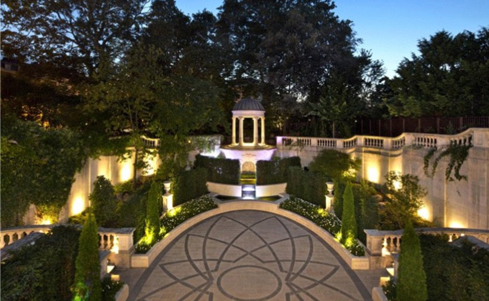 Dancing in the moonlight: The private Italianate gardens are dramatically lit and the perfect setting for summer soirees