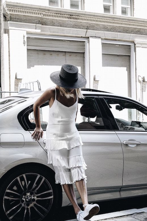 Le Fashion Blog Black Straw Hat White Pleated Dress White Keds Via The Grey Layers