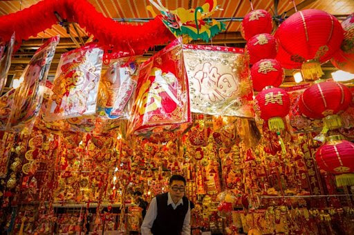 A man exits a shop selling Chinese New Year decorations, in Hong Kong, on February 5, 2013