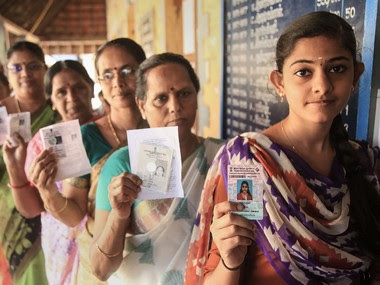 People wait to cast their votes during rural local body electons in Kanyakumari district of Tamil Nadu. PTI
