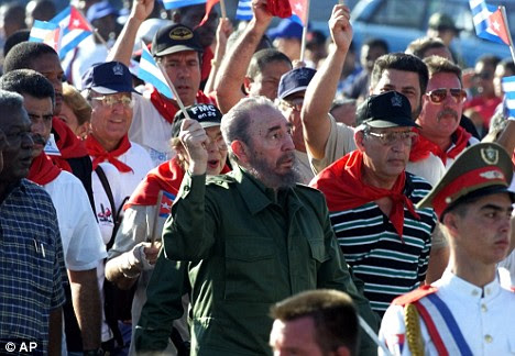 Fidel Castro, centre, pictured during a 2000 protest demanding an end to the U.S. embargo against his nation