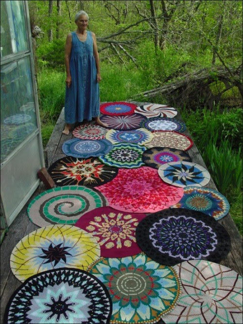 miss-mary-quite-contrary:  this is the one picture on the whole internets that made me want to learn how to crochet. i never did find the name of the woman pictured, but these are her stunning tapestry crochet mandalas