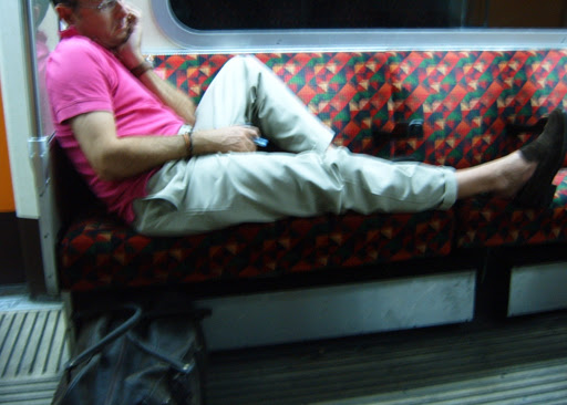 Man Sleeping on the District Line
