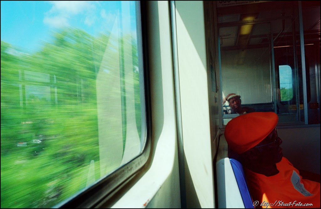 Two men riding Metrorail in Miami, Florida, USA, 2011. Street Photography of Miami, San Francisco and Key West by Emir Shabashvili, see http://street-foto.com, http://miamistreetphoto.com, http://miamistreetphotography.com or http://miamistreetphotographer.com