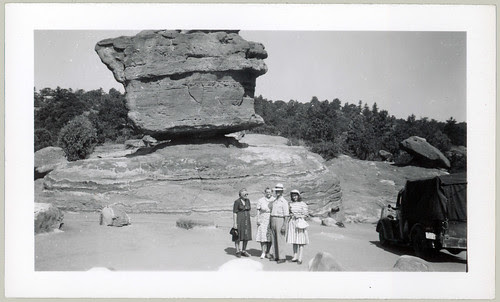 balancing rock and 4 people