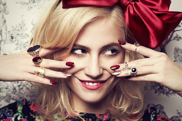 Lady in red: The singer shows off matching fingernails and hair accessories