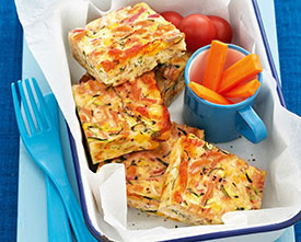 quiche cut into squares with a side of carrots